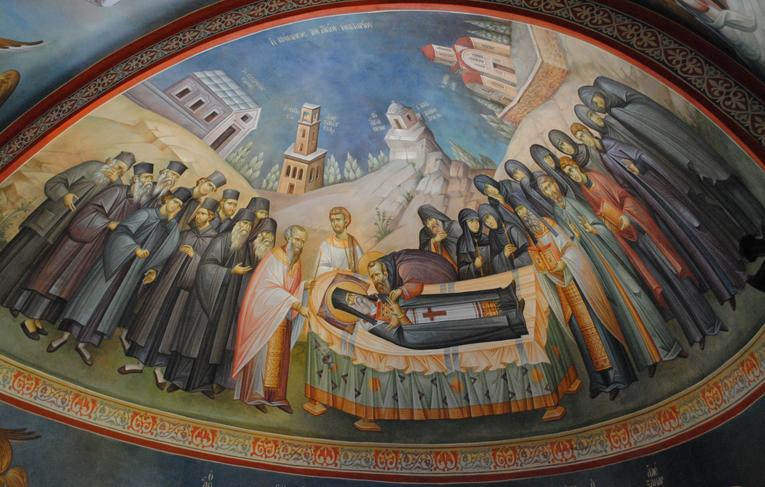 Αγιογραφία από την κοίμηση του Αγίου Νεκταρίου, στον Ιερό Ναό Αγίας Τριάδος στην Αίγινα, όπου κατά την κοίμηση του Αγίου δεν παρευρίσκονται Αρχιερείς, αλλά κληρικοί, μοναχοί, μοναχές και πιστός λαός.